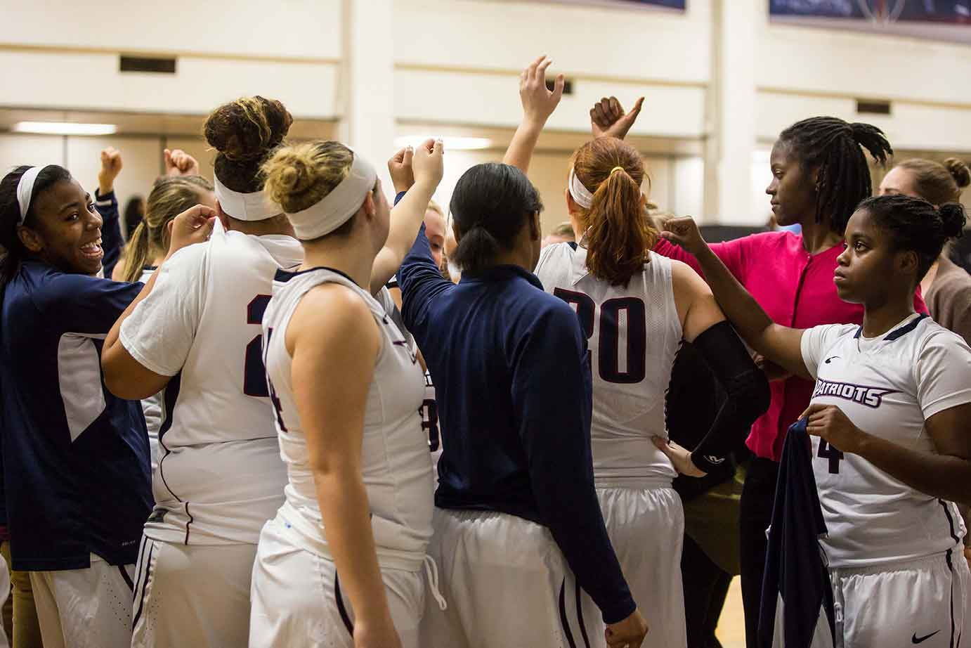Girls Basketball team group huddle before a game