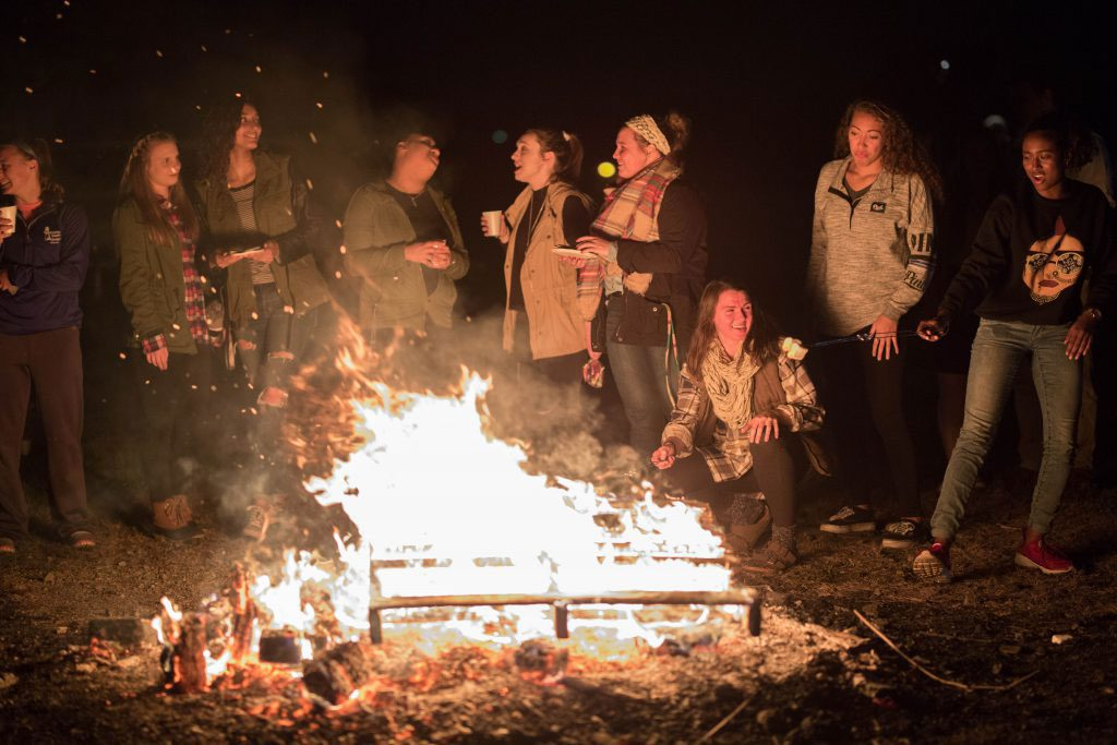 UVF Students gather around a fire for student life event