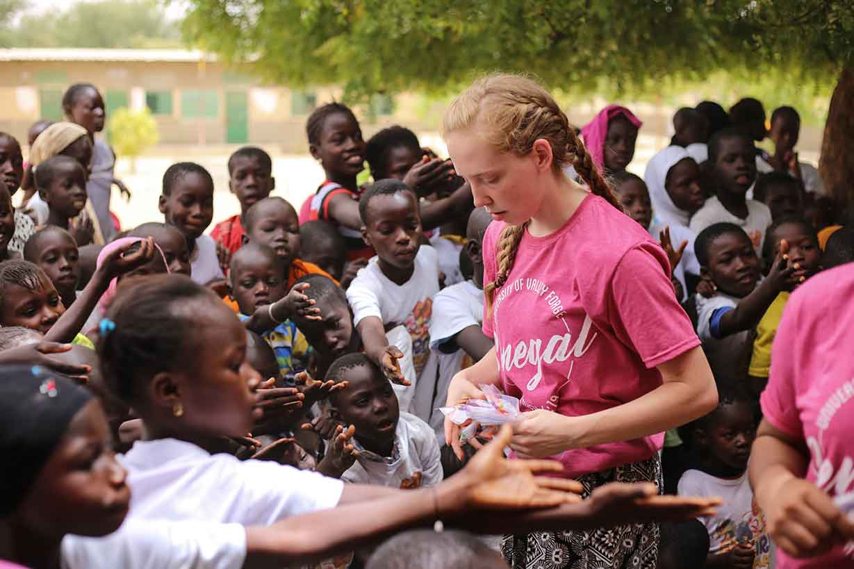 UVF student with Senegal children