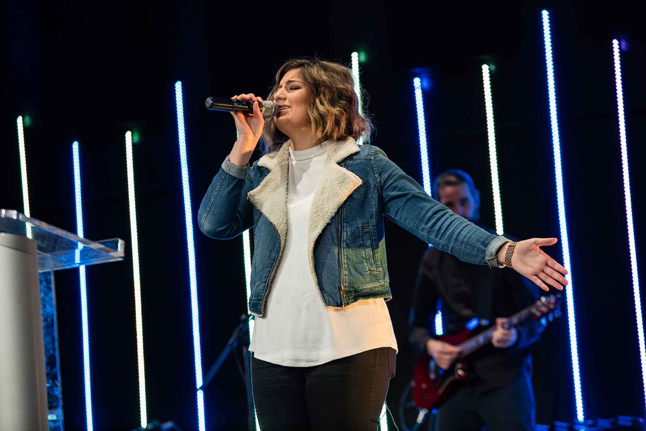 Student Leading worship on stage