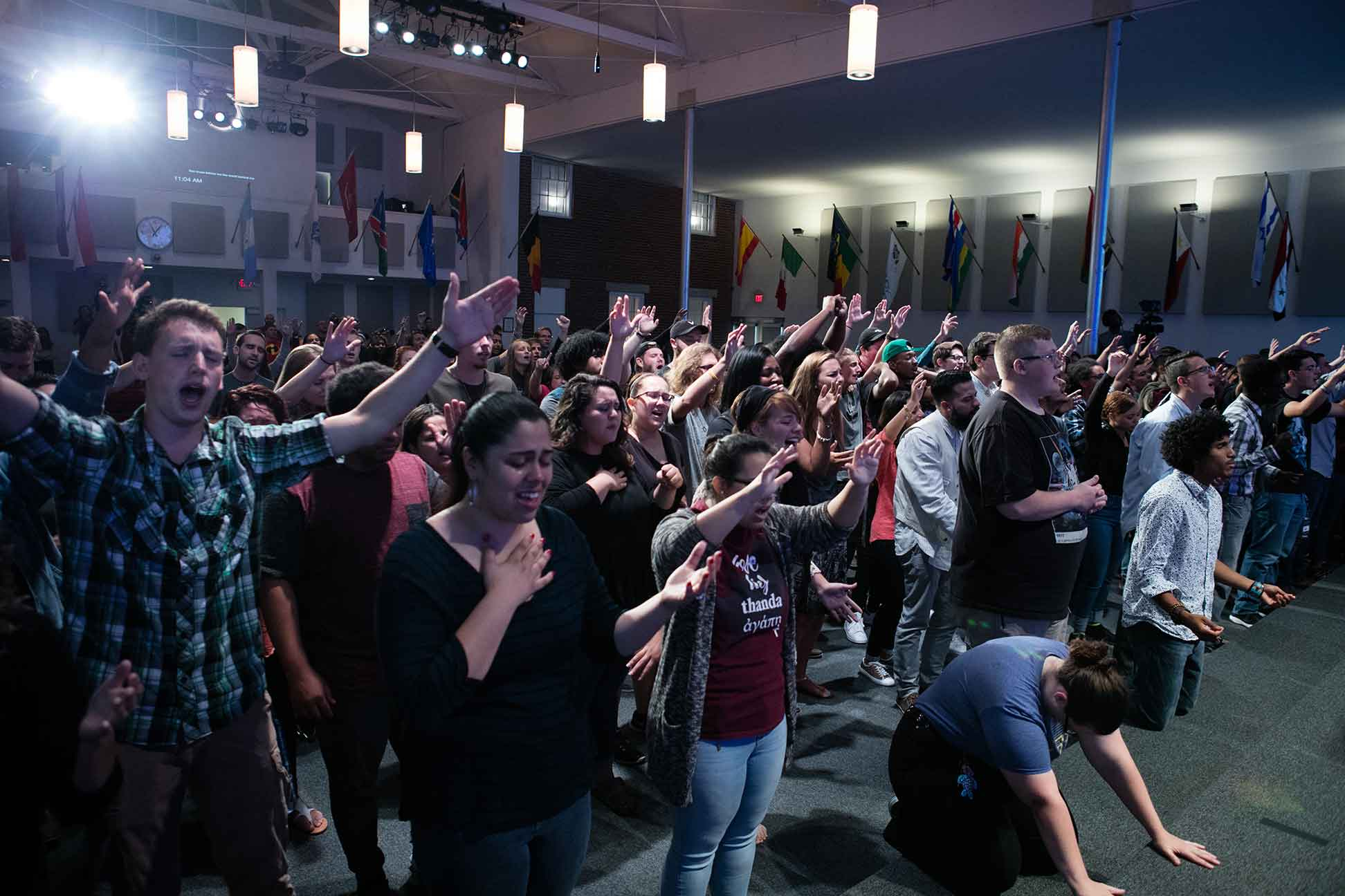 Group of students worshiping in chapel