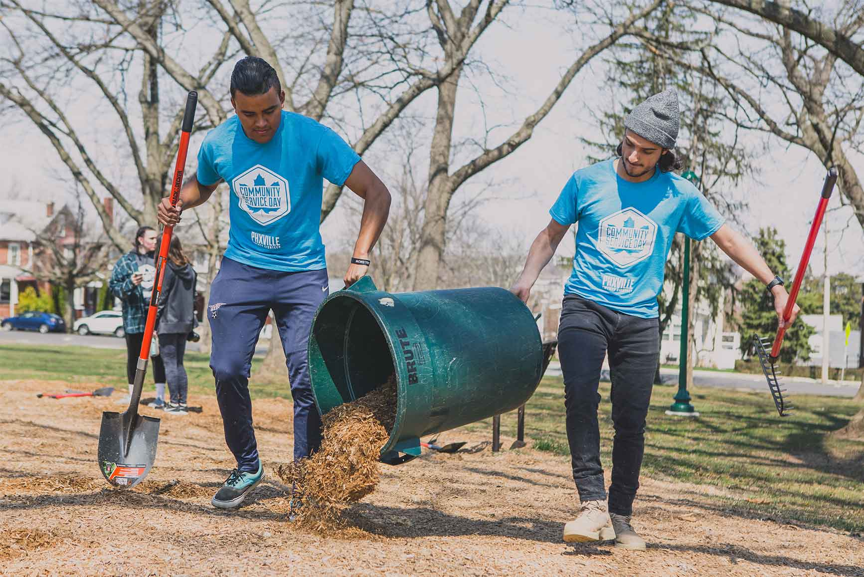 Two UVF students spreading mulch for Community Service Day