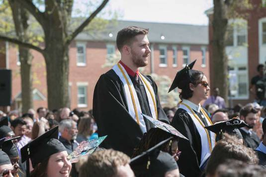 Honors students stand at graduation to be recognized