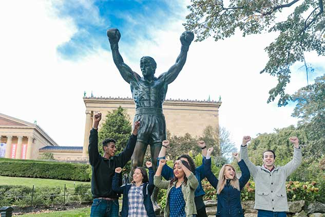 UVF Students posing with Rocky Statue in Philadelphia PA
