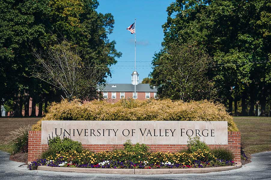 University of Valley Forge Sign with Harrup behind
