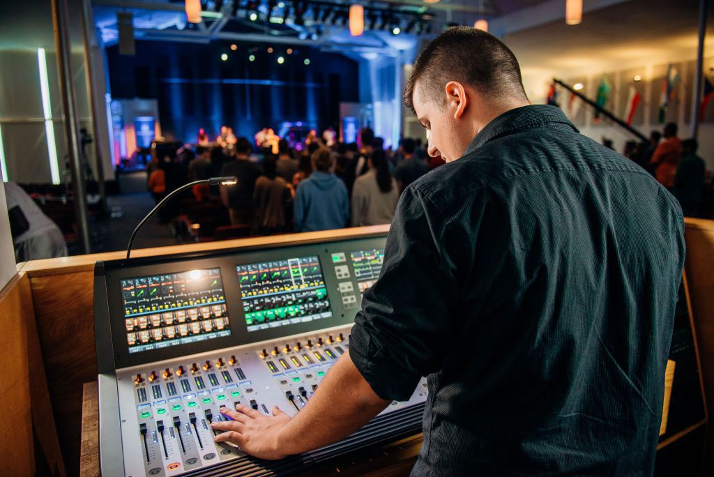 Student mixing sound in chapel