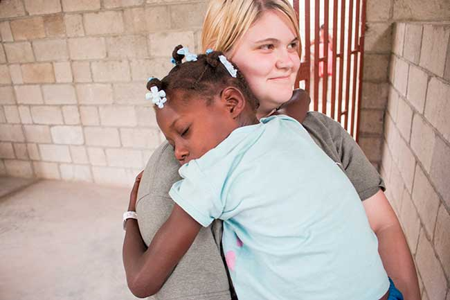 UVF student on the missions field with child