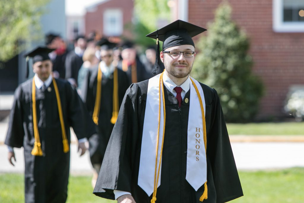 UVF Honors student walking to commencement ceremony