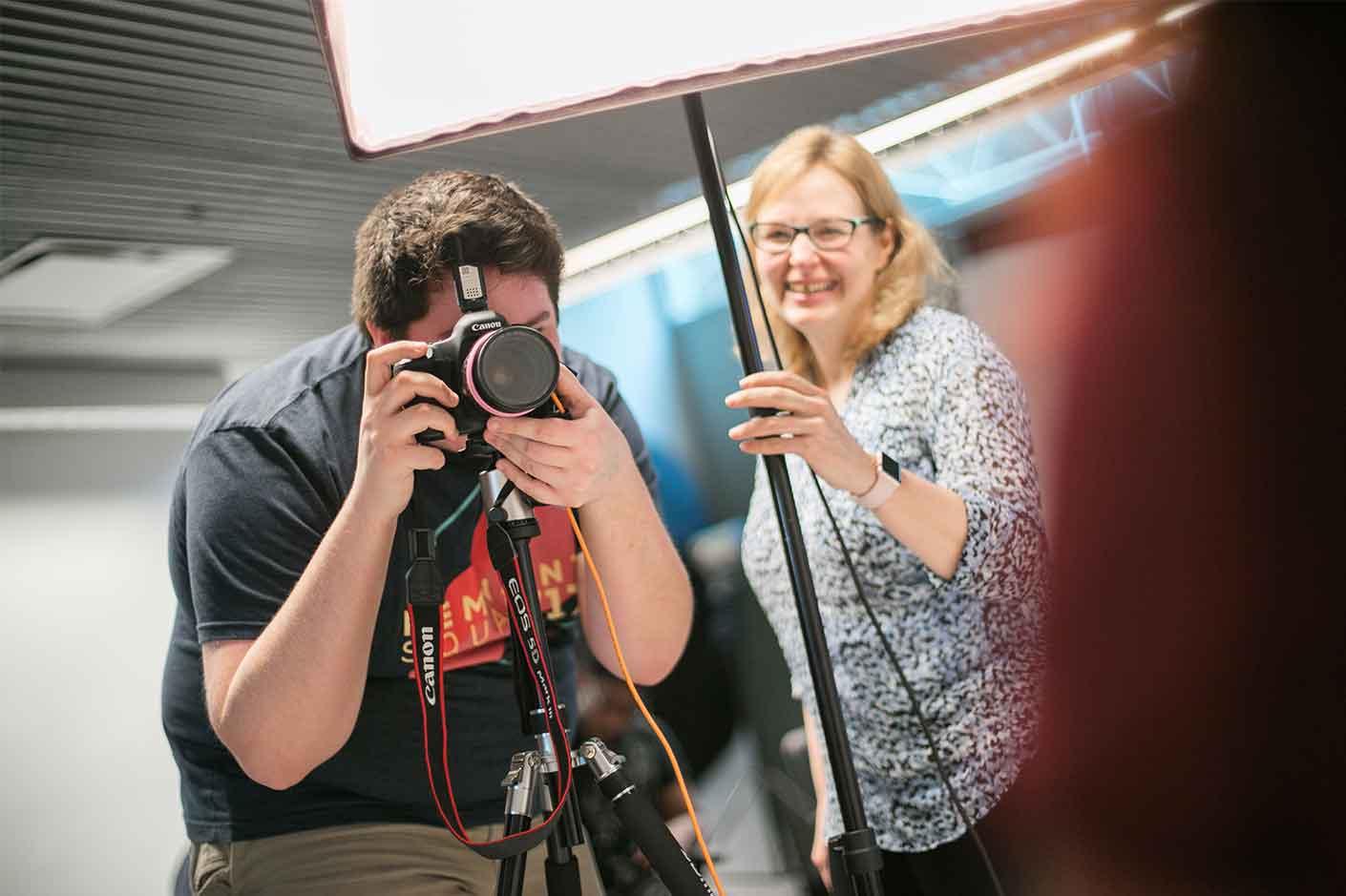 UVF Student taking photos in UVF Photography Studio