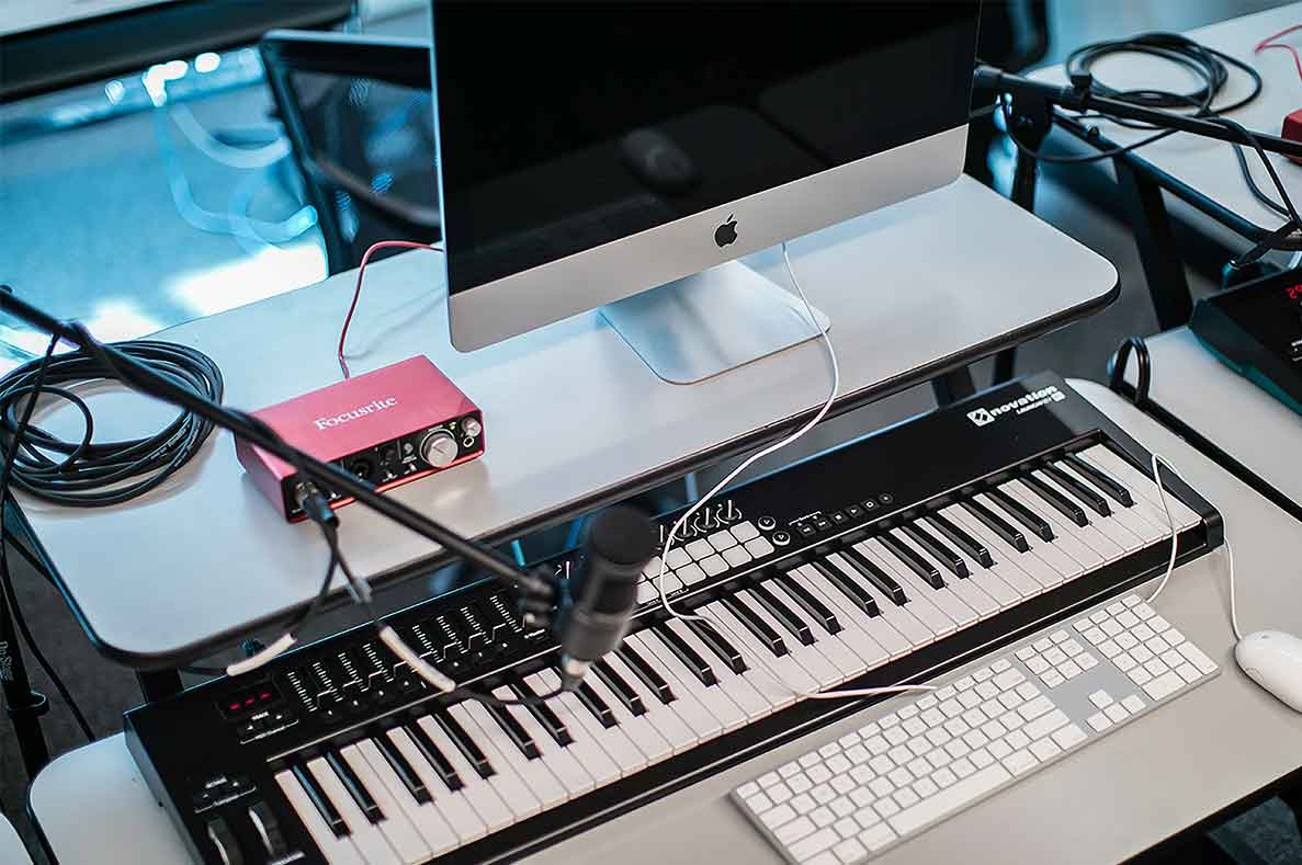 Photo of computer and keyboard piano in computer lab
