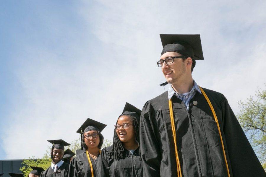 Graduates walking to graduation ceremony