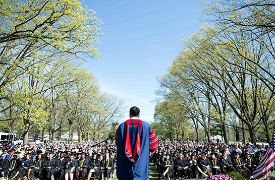 President speaking in front of graduating class