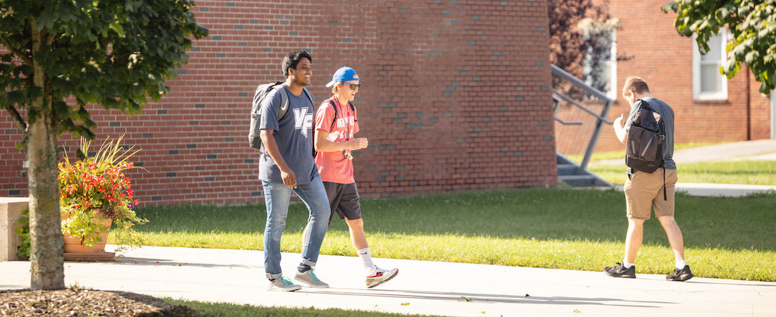 Students walking to and from class on campus