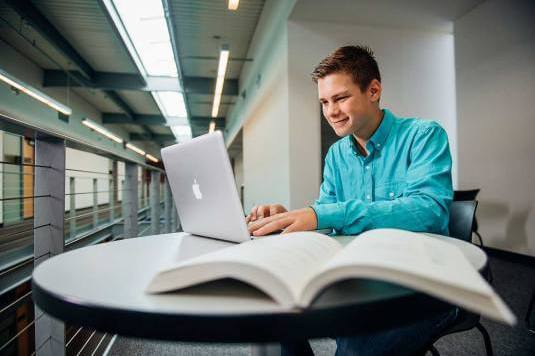 UVF Student Studying in Cardone Hall